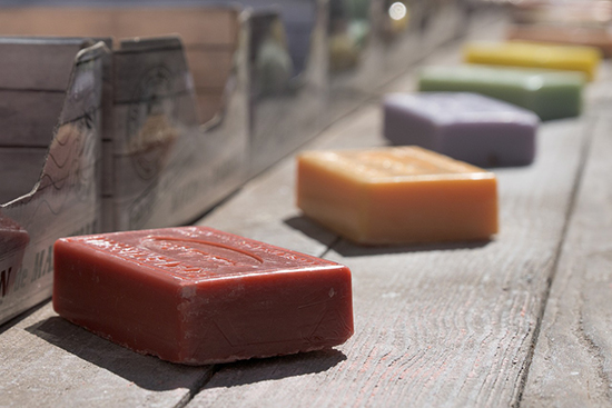Photo of rustic soap bars on a wooden table