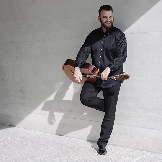 Lukasz Kuropaczewski with his guitar