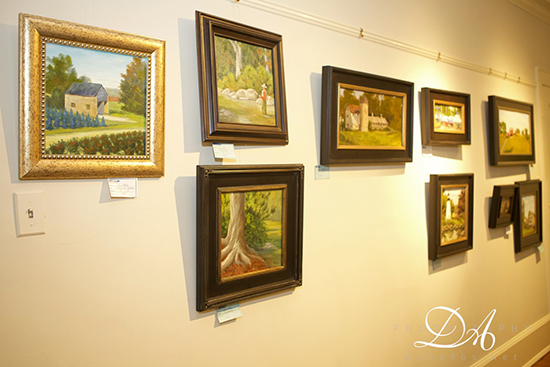 Plein Air Festival Paintings hang on gallery wall
