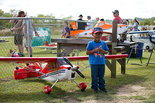 Photo of young boy with remote plane at Fly-In
