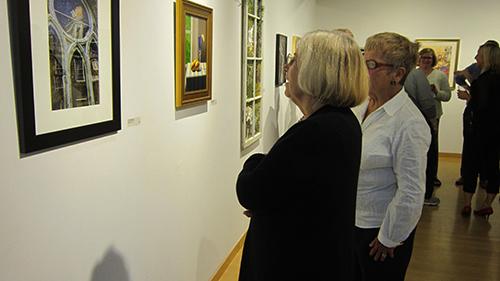 Reception guests enjoy an exhibit.