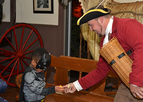 Young trick or treater meets colonial era man