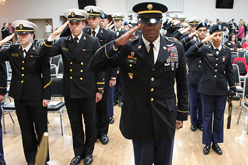 Active duty military perform an Honor Salute