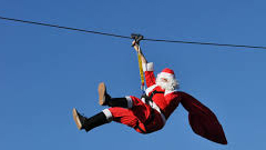 Santa soaring on a zipline