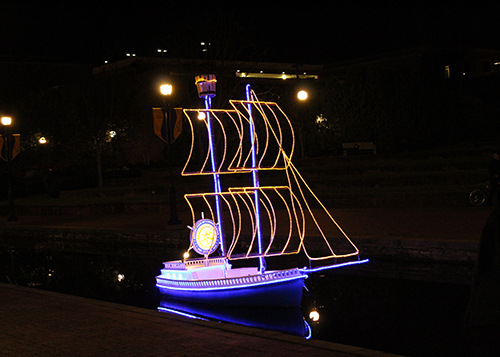 One of the seven sailing boats with lights