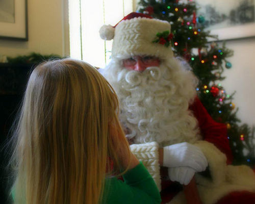 Young child talks to Santa