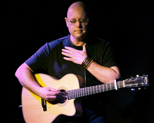 Bob Sima with guitar