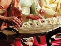 Japanese musicians playing Japanese instruments.