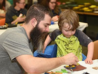 Photograph of father and son at Family Arts Day.