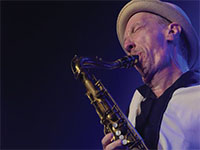 Picture of Bill Murray playing saxophone.