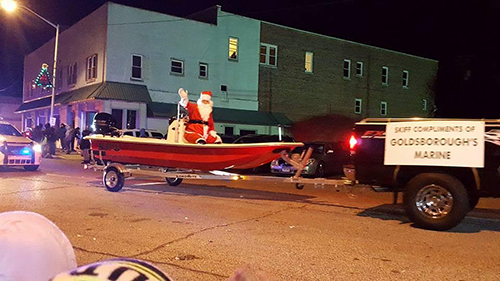 Santa arriving on a boat to Crisfield