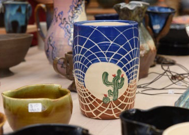 blue and white vase with a cactus design