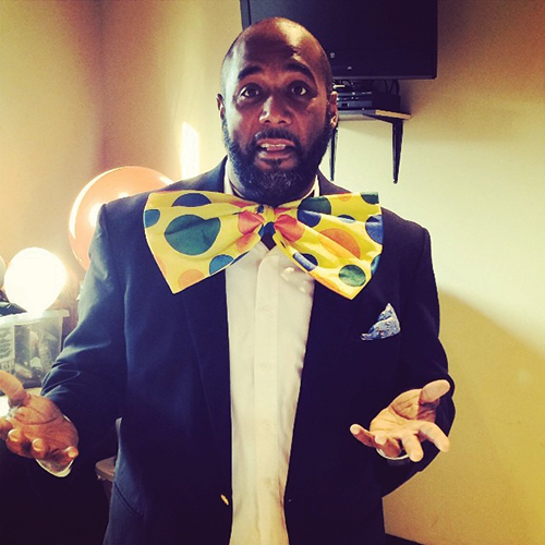 Alex Scott in large colorful bowtie