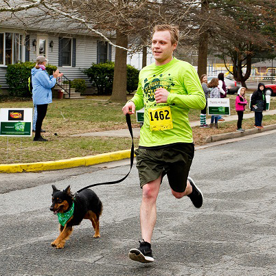 Man and dog run in St. Paddy's Day Race