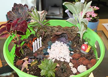 Child planting mini garden