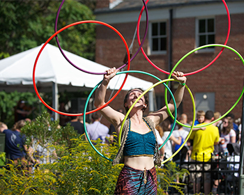 Performer Spinning Colorful Hoops