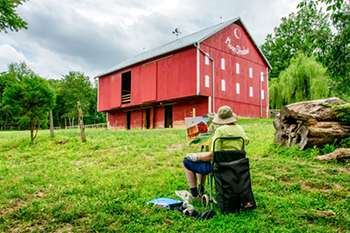 Artist Paints A Red Barn On the Tour