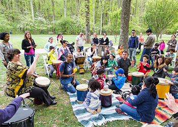 Adults and Children in a Drum Circle