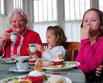 Mrs. Claus at a tea party with young friends