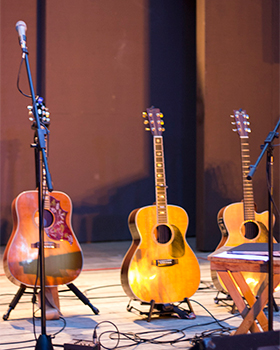 A Group of Guitars Lined Up on the Stage