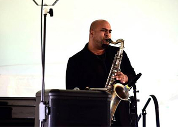 Man plays saxophone at the Festival