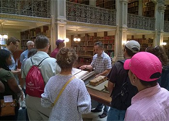 Guide Paul Espinosa with a tour at Peabody Library