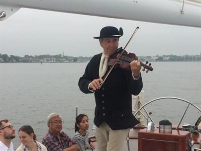 Tom Guay aboard the Schooner Woodwind.