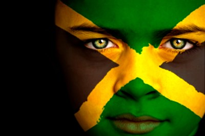 Jamaica flag projected onto a woman's face.