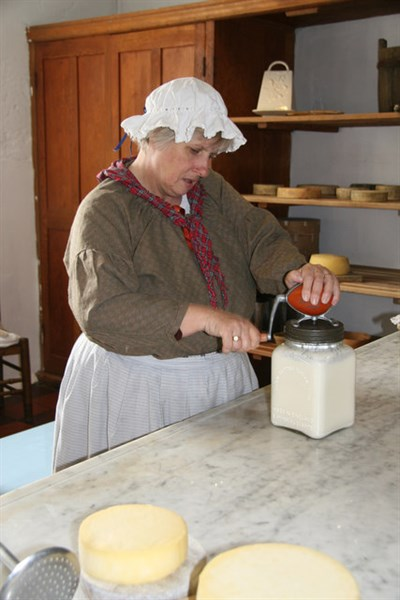 A lady making butter