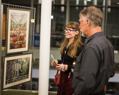 People view artists' images at Gallery Sale