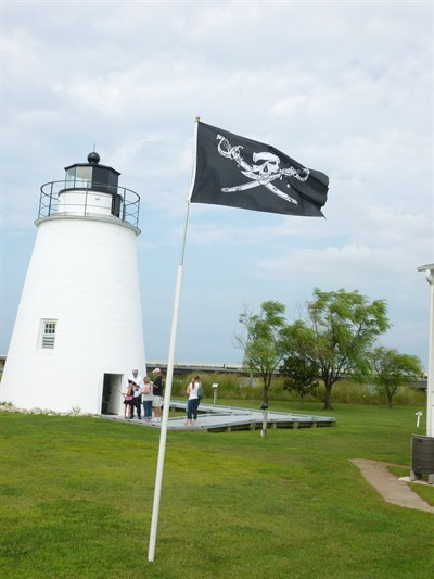 Lighthouse with Pirate Flag
