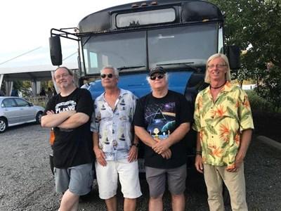 Tranzfusion rock band at their tour bus.