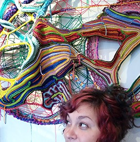 Christine Wolfe Strong with a crochet sculpture in progress.