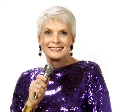 Jeanne Robertson holding microphone
