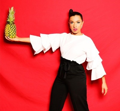 photo of banda magda holding a pineapple