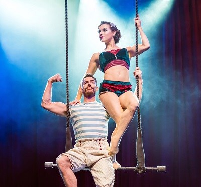 two people on a trapeze swing