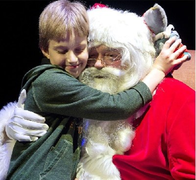 photo of Santa Claus and child