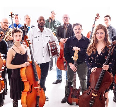 group photo of portland cello project holding various instruments