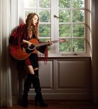 Calista Garcia playing guitar
