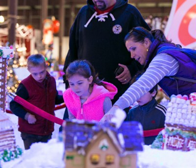 Kids looking at gingerbread houses