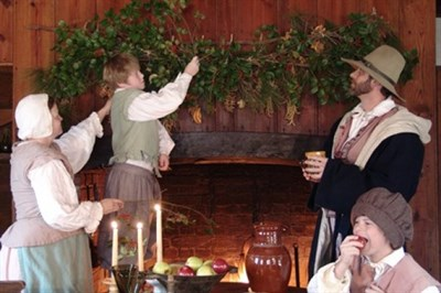 Colonial family celebrating the holidays