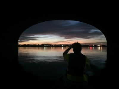 Paddler during a Full Moon