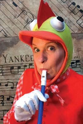 Person dressed as chicken playing a recorder