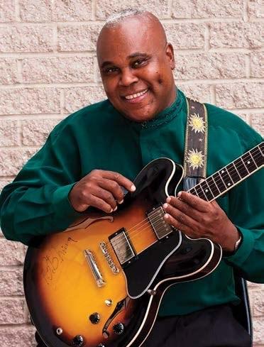 Memphis Gold holding a guitar