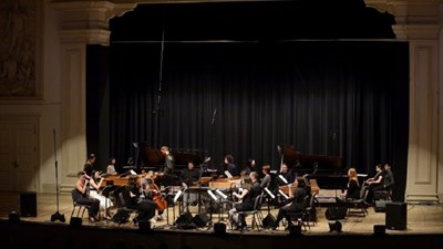 An Orchestra Performing on Stage