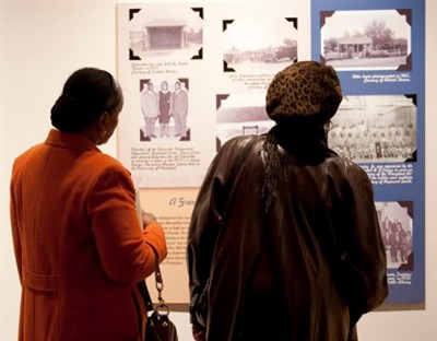 Women looking at exhibit