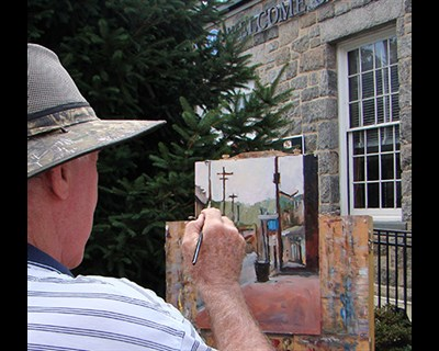 Artist Raymond Ewing at his easel at Paint It! Ellicott City 2017