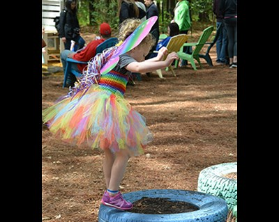 Young girl at play in the outside Fairy Lolly