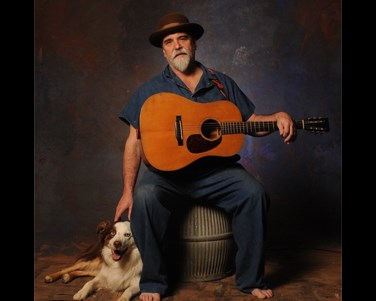 Darrell Scott with his guitar and his dog