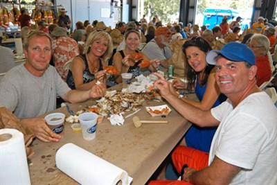 People enjoying seafood at the festival